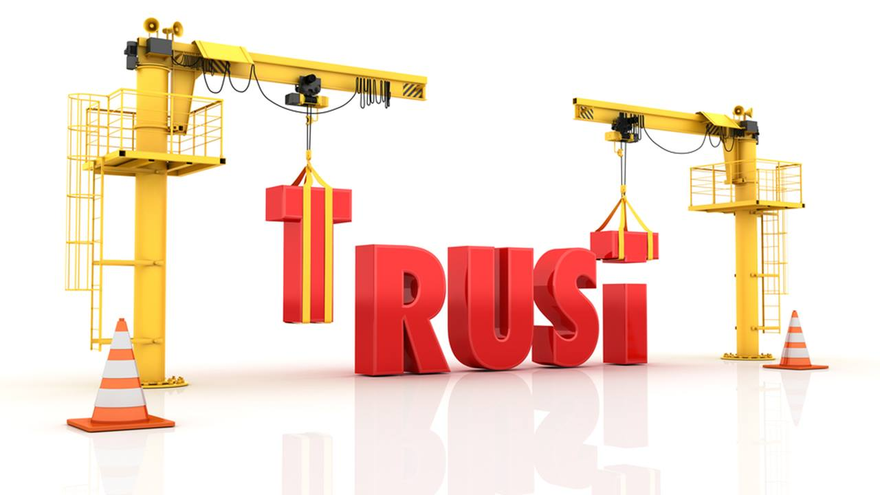 "the word ""trust"" which is built with two cranes to symbolize the trust of the German markets"